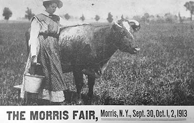 Flyer for the fair.  A girl with a cow