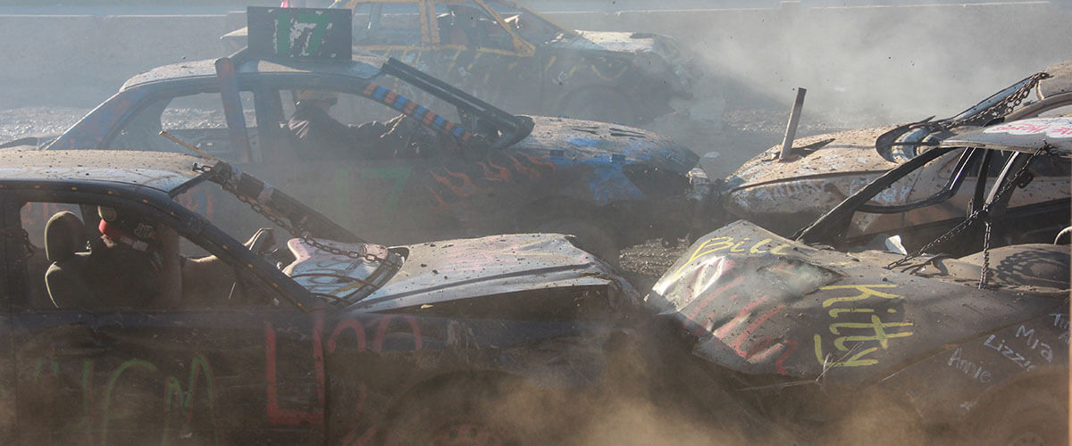 Cars crash into each other in the 2015 Demolition Derby